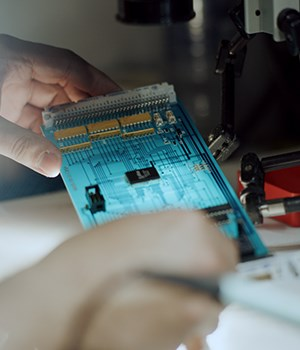 Engineer with circuit board in workshop
