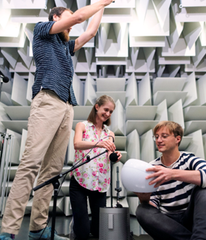 Noise and acoustics engineers test products in anechoic chamber